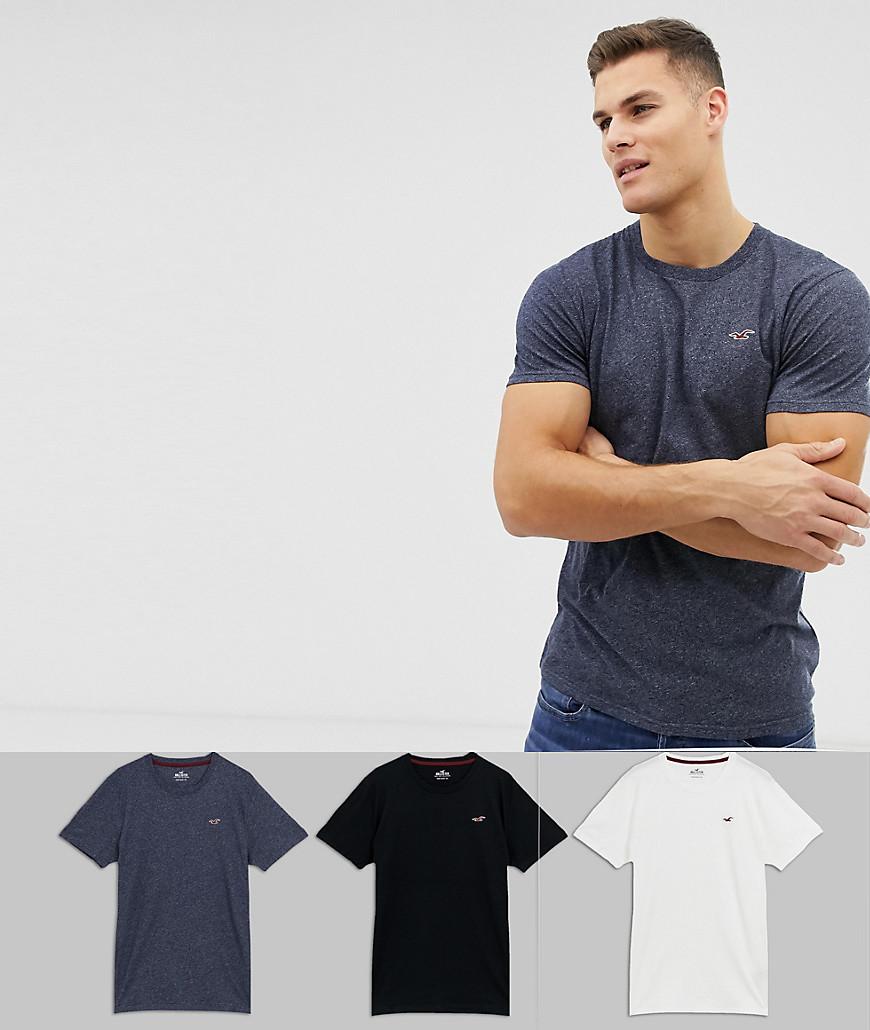 Hollister - Schmale T-Shirts im 3er-Set in Weiß/Marine meliert/Schwarz mit Rundhalsausschnitt und Möwenlogo - Mehrfarbig