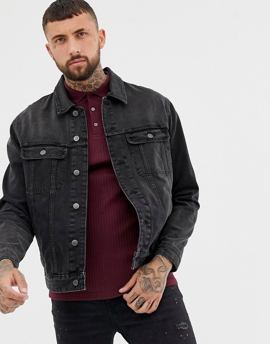 ASOS DESIGN - Übergroß geschnittene Jeansjacke in verwaschenem Schwarz - Schwarz