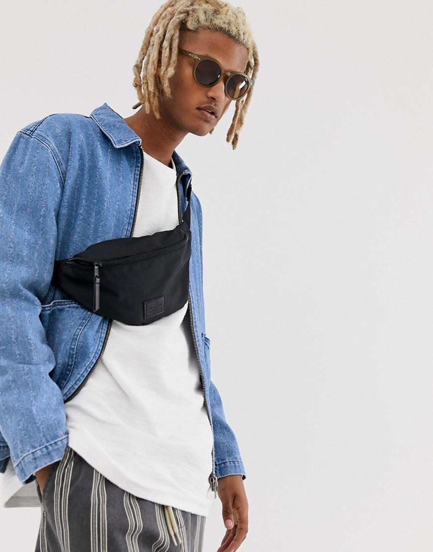 ASOS DESIGN - Jeansjacke im Arbeiter-Stil mit Abnutzungseffekten und Reißverschluss - Blau